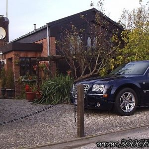 Chrysler 300C Hemi V8 and my motorhome in front of the house