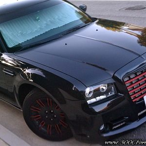 300c tricked out grill, body kit, blacked out and customized.
